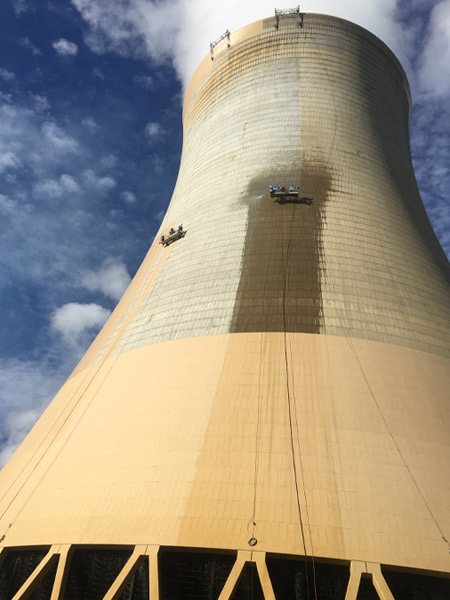 Ausvic applying protective coating on cooling tower
